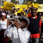 Activists & Second Line musicians rally to city hall